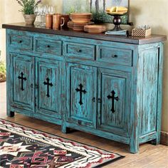 """""""turquoise & crosses"""" Not a fan of that many crosses, but I LOVE the antique blue and dark-wood shelf top :D"""