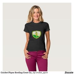 Cricket Player Bowling Crest Cartoon Tee Shirt. Cricket World Cup women's t-shirt with an illustration of a cricket player fast bowler bowling with cricket ball set inside shield crest viewed from front done in cartoon style. #cricket #cricketworldcup #t20worldcup #worldtwenty20 #t20worldcup2016