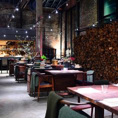 Saison, San Francisco... Unbroken by partition walls of any sort, the interior is dark and red and woody, with nice personal touches like the cashmere shawls over the backs of chairs providing both texture and warmth...