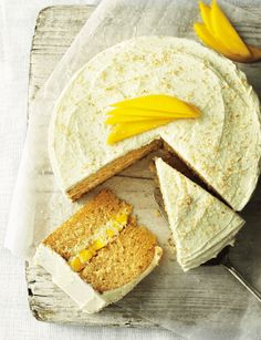 Lightly toasted desiccated coconut and a white chocolate buttercream complement the fresh mango in this light and fruity summer cake recipe. White Chocolate Buttercream, White Chocolate Cake, Summer Cake Recipes, Summer Cakes, Cupcakes, Cupcake Cakes, Mango Chocolate, Mango Cake, Paleo