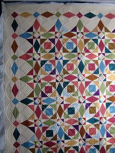 Sheri's quilt took longer than planned: I always forget how long it takes to do lots of SID and background quilting.  (Picking out s...