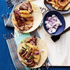 "Tacos al Pastor | ""Tacos, whiskey, hillbilly music""—that's the promise of Chicago's Big Star, famed chef Paul Kahan's project with Donnie Madia and mixologist Michael Rubel of Violet Hour. Though they call the place a dive (it's not), the classic tacos—like the exceptional grilled-pork one here—are impressively fresh. And there's a take-out window."