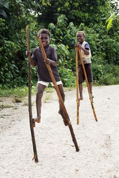 Boys walking on stilts in Solomon Islands. Photo by Rob Maccoll for AusAID Tonga, Top Toddler Toys, Vanuatu, Boy Walking, Human Dignity, Solomon Islands, Teaching Activities, Cook Islands, Papua New Guinea