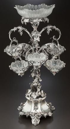 A THOMAS BRADBURY & SONS SILVER-PLATED AND CUT GLASS FIGURAL EPERGNE. ca.1870