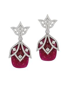 Andreoli earrings with carved Burmese rubies and diamonds---Earrings in 18k gold with 48 cts. t.w. carved Burmese ruby and diamonds, $38,000; Andreoli