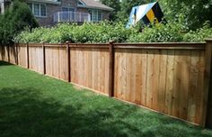 Traditional wood fence with a custom top rail designed and installed by First Fence Company in Hillside IL Diy Fence, Wooden Fence, Fence Ideas, Porch Ideas, Yard Ideas, Custom Woodworking, Woodworking Projects Plans, Wood Fence Installation, Fence Builders