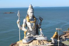 Lord Shiva at Murdeshwar in the backdrop of the Arabian Sea. Murdeshwar is about 165kms from Mangalore and has an ancient Murdeshwar Temple. This temple embodies a Shiva Linga is believed to have erupted when Ravana (Demon King of Lanka) flung the cloth covering the Atmalinga at Gokarna while lifting it. Lord Shiva, following a complicated sequence of events, declared that Murudeshwara should be one of his five holy places.