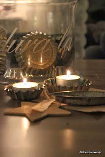 Tea lights in cup tins