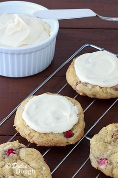 These soft, chewy rhubarb cookies are flavored with coconut, sweetened with brown sugar, and topped with vanilla cream cheese frosting.
