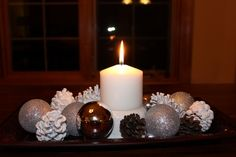 A display using christmas ornaments and my white pinecones.