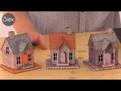 Have you seen the 3D houses by Tim Holtz? Here Pete Hughes uses the Village Dwelling XL die and our free paper downloads to create gorgeous little papercraft...