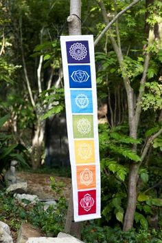<p>This banner features the 7 main chakras and their corresponding colors and lotuses. Each chakra represents a different physical part of the body, such as the crown chakra at the top of the head to the root chakra which is located at the bottom of the spine.</p> <p>Chakras are also a way for the body and mind to connect spiritually. Yoga enthusiasts often refer to these areas as energy points. </p> <p>This banner is not hand painted.<&#x2F...