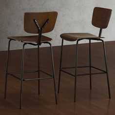 @Overstock.com - Reed Medium Walnut/ Charcoal Bar Stools (Set of 2) - These Reed bar stools feature an updated school house look with a steel frame and wood seats and backs. These bar stools are sturdy, fully assembled and come with non-mar adjustable foot glides.     http://www.overstock.com/Home-Garden/Reed-Medium-Walnut-Charcoal-Bar-Stools-Set-of-2/6839570/product.html?CID=214117  $229.99