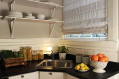 Clear and white kitchen storage.  Crystal's Dramatic Home in San Francisco