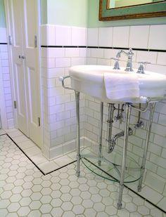White hexagonal floor tiles and white subway tiles. Pedestal sink. (Photo: Bungalow Tile)