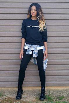 Slim looks amazing in her UO sweatshirt, tank, and flannel #UOonyou #docmartens