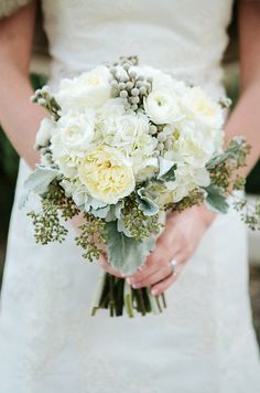 How elegant and romantic is this bouquet? Soft whites and shades of greens are fabulous for an outdoor spring wedding.