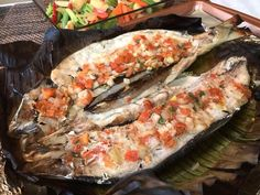 Baked Bangus, also known as Milk Fish is easy to cook and very healthy. This Baked Bangus is really simple using ready-store bought cleaned and boneless milk fish. The bangus is stuffed with ginger… Fish Recipe Filipino, Easy Filipino Recipes, Filipino Dishes, Filipino Food, Pinoy Recipe, Pinoy Food, Fish Recipes, Seafood Recipes, Cooking Recipes