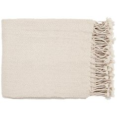 A wonderfully soft, woven throw blanket in a comforting and muted cream color.