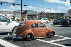 Love how the wide rear wheels fill the fenders on this slammed Oval Beetle.