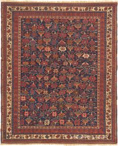 Botanical Afshar Antique Persian Rug with allover blossom pattern in gold, red and blue Antique Rug - Claremont Rug Company