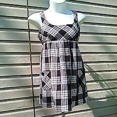 "Plaid Jumper with Pockets Black & white with faint red lines. Skirt gathers at empire waist, for a flowy flattering fit. Hidden side zip. Buttons on pockets.  Measured flat 18"" across bust. 32"" long top to bottom. On 36"" x 31"" x 36"" mani 65% poly, 35% rayon. SO Dresses Mini"
