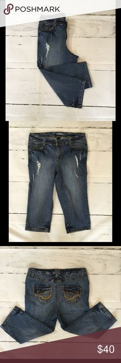 """Lane Bryant distressed denim capris Size 14 These distress denim capris are fun and fashionable with 5 pockets, zipper and button up, blinged out back pockets, thick stitching, and rivets on front pockets. Great pair of capris that are a must! 99% cotton, 1% spandex. Lane Bryant Size 14. Measurements W17 1/2"""", I19"""", L30"""". Washed and stored in excellent condition! Lane Bryant Jeans Ankle & Cropped"""