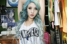 Mint/silvery tresses. Long side parted wavy light
