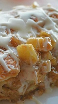 Delicious Apple Fritter Breakfast Casserole _ Out of this world amazing! Layers of flaky croissants, caramelized apples & cream flavored with Apple Butter, then glazed. Is there anything more beautiful than apple chunks swimming in sugar & butter?!