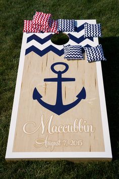 Personalized cornhole set - perfect for guests to play during cocktail hour!  {Candace Jeffery Photography}