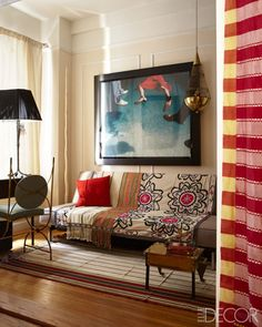 The guest room features a photograph by the Sanchez Brothers, throws from Uzbekistan and Yemen, and a Yemeni rug.