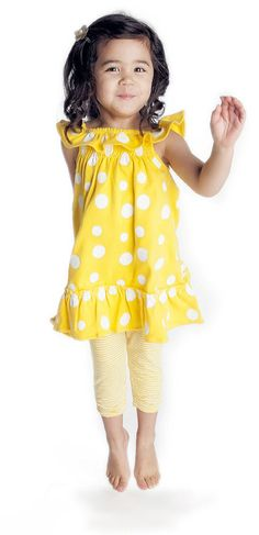 """spring 2013 childrenswear designer's favorite: Nosilla's Dandelion Dot Ruffle Dress/Dandelion Synch Capri. """"I love the retro, Sixties' feel this print has; yet our ruffle dress is fun, bright and girly for the little one who will wear it,"""" says Allison Grace."""