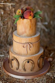 wedding cake with horse shoes and fruit.