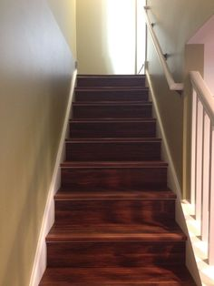 Installed vinyl planks directly on top of the old plywood basement stairs and capped it off with matching vinyl stair nose trim. Worked beautifully. Build Direct Vesdura Sumac Vinyl Planks