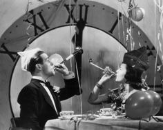 New Year's Eve over the years- A couple rings in the New Year with party blowers and streamers, circa 1930. Photo: FPG, Getty Images
