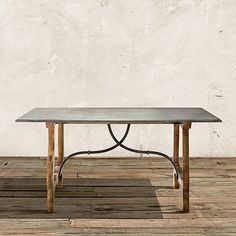The Luca dining table collection features a beautiful weathered table base complimented by a stunning blue stone top. The rectangle dining table is a