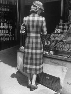 Fall Fashion: Block plaid coat. Note how skilled cutting of the back brings blocks into points at the waistline, achieving a thinning effect.  Location:	US  Date taken:	1938  Photographer:	Alfred Eisenstaedt