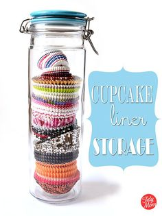 Clever and attractive storage solution. Use tall storage jars to organize and store cupcake liners! They keep their shape, easy to see what you have and look pretty on a shelf or counter!! find more on http://TidyMom.net