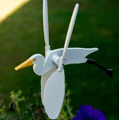 This hand cut, painted, and assembled Great Egret Whirligig is a perfect addition of color and movement to a garden, window box, or even just as a decoration inside. This is a medium-small mobile, six inches in length. All materials used (wood, paint, and shellac) are zero VOC and completely non-toxic.