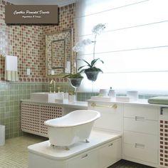 Delicadeza, elegância, funcionalidade definem bem esse banheiro todo em pastilhas de vidro em tons verde e terrosos.