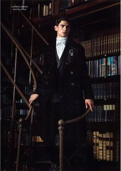 """""""The Librarian"""" -- A series of several photos of the same rather hunky """"librarian"""" model, Arthur Gosse, wearing different outfits but in the same setting, for the Fall/Winter issue of """"AnOther Man"""" magazine."""