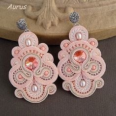 Although this is soutache jewelry (wrapped braids), it could be simulated in quilling.