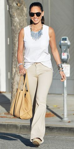 Munn's off-duty look was equal parts casual and polished—she half-tucked a sleeveless white top into wide-leg khakis, complete with a statement bib necklace, a stack of bracelets, and neutral tote.
