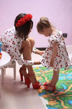Cute matching outfits! I wouldn't wear cherries but the idea is cute and I love her heels lol