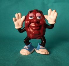 LOL! I loved the California Raisins. I used to watch their Christmas special every year. I had this little guy & 1 or 2 others. They looked like turds w/ limbs!