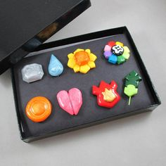 What a cute present- perfect for a few people I know :P Pokemon Gym Badge Set - Kanto Region