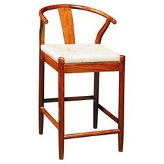 """Oak wood counter stool with a curved back and woven rush seat.  Product: Counter stoolConstruction Material: Oak and rushColor: Brown and naturalFeatures: Hand-wovenDimensions: 37"""" H x 21"""" W x 19"""" D"""