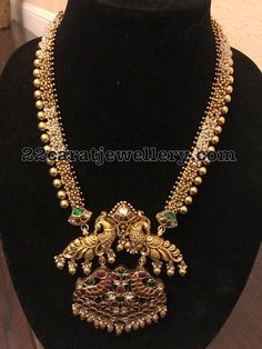 Gold Long Chain Two Step Peacock Pendant