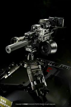 caliber style assault rifle with a suppressor, a spade grip Eotech holographic sight, a 100 round drum magazine, a wide base, low clearance tripod mount. Weapons Guns, Military Weapons, Guns And Ammo, Zombie Weapons, Military Gear, Assault Rifle, Cool Guns, Tactical Gear, Zombies