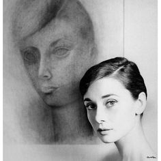 Audrey Hepburn photographed next to her portrait by Mexican artist Rufino Tamayo, 1957